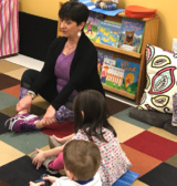 Deb Ronga Of Lotus Lil Teaching Yoga To Kids At Sunshine Nursery School.