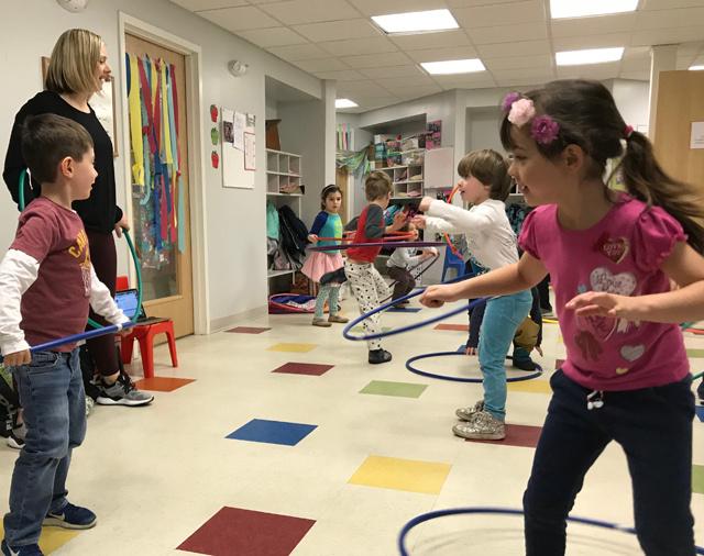 Miss Jen of Lynn & Jen's Dance Studio in Arlington got kids at Sunshine Nursery School to engage in some creative movement.