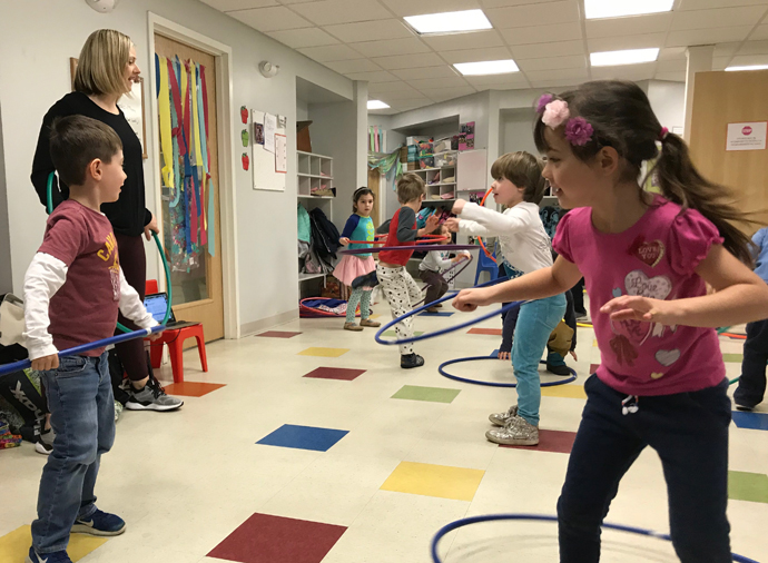 Miss Jen of Lynn & Jen's Dance Studio in Arlington got kids at Sunshine Nursery School to engage in some creative movement.