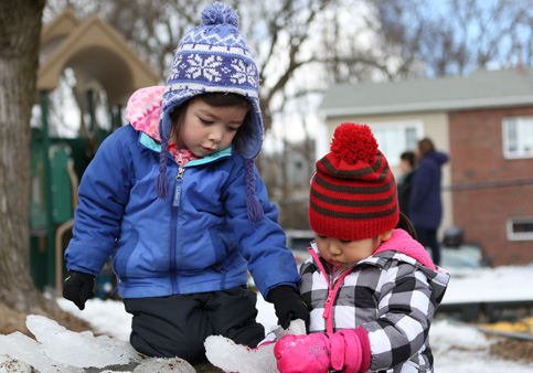 Kids from threes classroom enjoying a nice winter day at the Sunshine Nursery School playground.