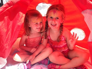 Two Sunshine Nursery School summer camp kids having fun in the tent.