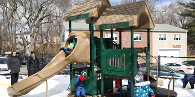 Kids playing at the playground adjacent to Sunshine Nursery School.
